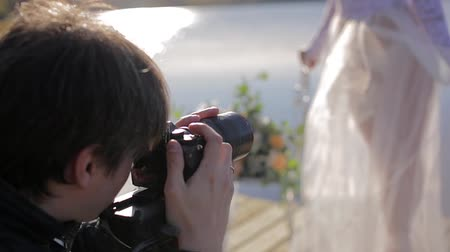 dop : Man taking photo with professional camera of bride