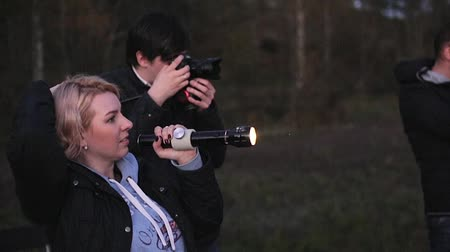 dop : Photographer and assistant with camera and light outdoors