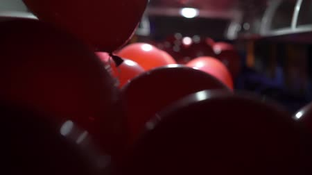 balonlar : Red balloons inside a bus at night celebration