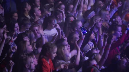 girl claps : SAINT-PETERSBURG, RUSSIA - MARCH 11, 2018: People dancing at the concert in club slowmotion