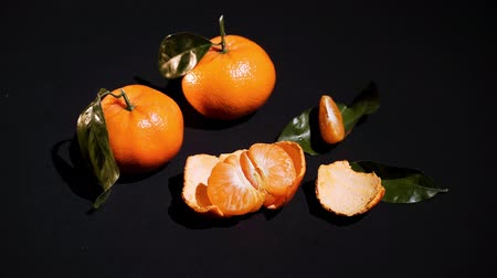 juicy : Two citrus mandarin with leafes on black background isolated animated