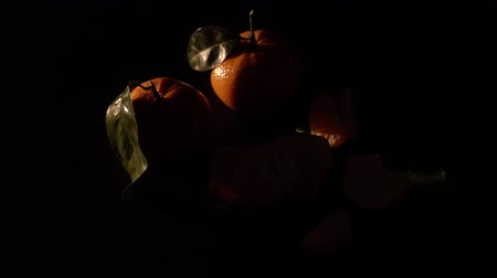 tangerina : Two citrus mandarin with leafes on black background isolated