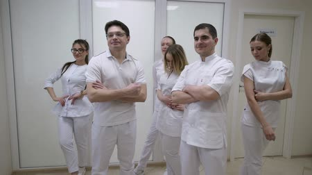 cardiologista : Doctors in hospital in white uniform posing Stock Footage