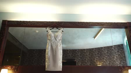 Bridal dress at the mirror in bedroom Stock mozgókép