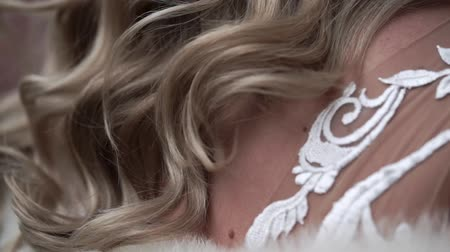 Young blonde bride waving hair closeup slowmotion