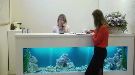 Reception in clinic hospital, two women working