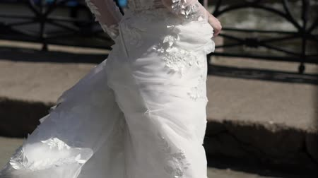 nevěsta : Bride circling in a city and waving white bridal dress
