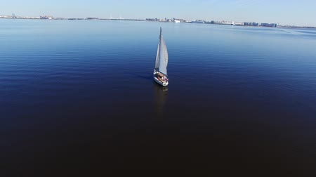 żaglówka : Sailing yacht in a sea aerial quadcopter shot Wideo