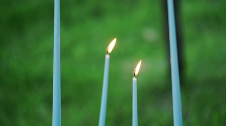 свечи : Blue candles outdoors at the evening