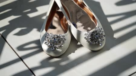 pastas : White womans bridal shoes at balcony
