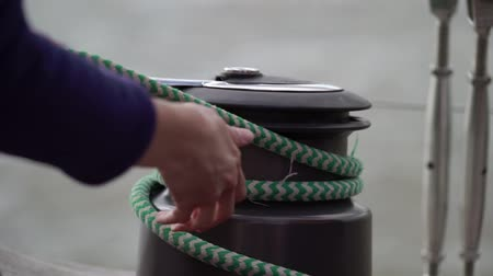 regaty : Rope windlass on sailing yacht at windy sunny day