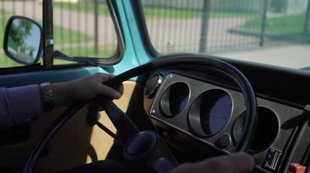 volkswagen : Blue retro bus driving in a city Stock Footage