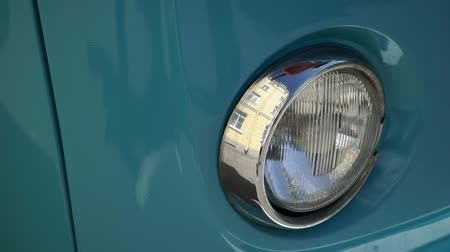 volkswagen : Headlight lamp of blue retro bus