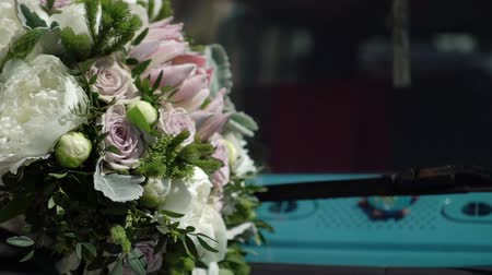 eski : Bridal bouquet on a hood of blue retro old bus Stok Video
