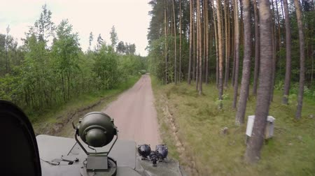 tracked : Tank driving in forest at cloudy day Stock Footage