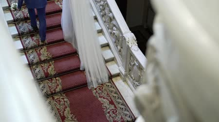 nowożeńcy : Bride and groom going upstairs in palace