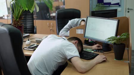 tükenme : People sleeping in office at work places Stok Video