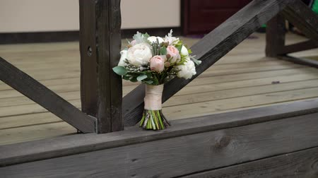 veranda : Bridal bouquet with peonies otdoors