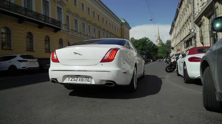 st : SAINT-PETERSBURG, RUSSIA - AUGUST 4, 2018: Luxury Jaguar cars driving in a city street in Europe at summer sunny day
