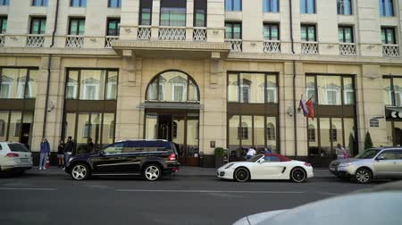 road sign : SAINT-PETERSBURG, RUSSIA - AUGUST 4, 2018: Luxury cars near hotel building in a city