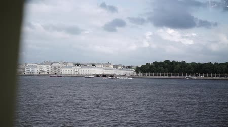 st petersburg : Passenger ships and river trams in city river at cloudy day. River Neva in Saint-Peterburg, view on Summer garden Stock Footage