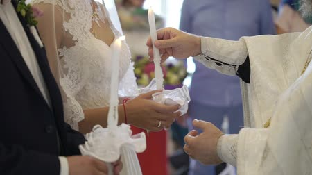 paus : Bride and groom holding candles in church at christianity wedding ceremony Stockvideo