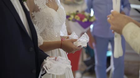 clergyman : Bride and groom holding candles in church at christianity wedding ceremony Stock Footage