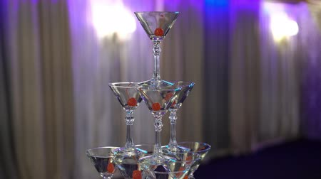 Pyramid tower of glasses for champagne at the party in restaurant indoors steadicam