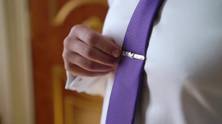 Man pilot put on violet tie with airplane
