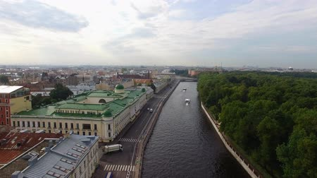 Aerial drone view of historical city center embankment in european city. Saint-Petersburg in Russia. Old buildings near river. Sunny summer day. River Neva and ships. Wideo