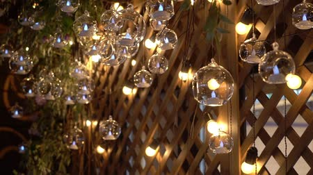 electric : Hall of a hotel or restaurant, chandelier in the lobby, Chandelier hangs from the glass balls, creative, modern, interior, hotel or restaurant interior. Decoration at the wedding dinner reception Stock Footage