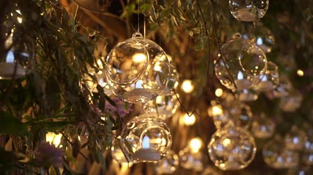lobby : Hall of a hotel or restaurant, chandelier in the lobby, Chandelier hangs from the glass balls, creative, modern, interior, hotel or restaurant interior. Decoration at the wedding dinner reception Stock Footage