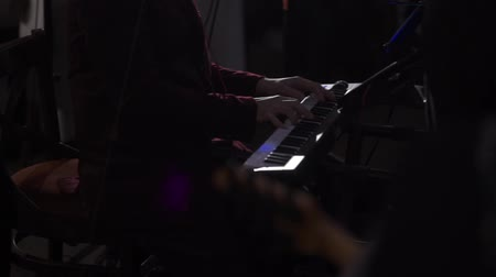 zongora : Musician man play keyboard piano on dark stage