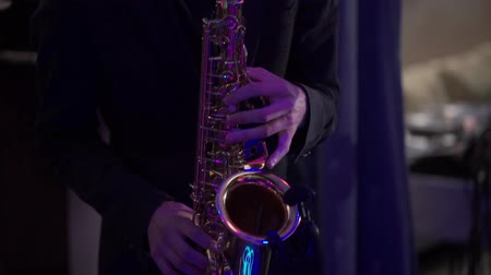 jazz festival : Man plays on a saxophone at the stage with band Stock Footage