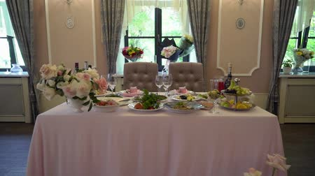 reception : Festive wedding table setting with pink flowers, napkins, glasses and pink box table decor.