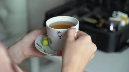 latte : Woman holding hot cup of tea. White mug, drinking hot tea or coffee