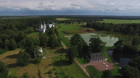 csak : Beautiful wedding ceremony decoration. Aerail drone shot in park with pond and palace building, country side at sunny summer day