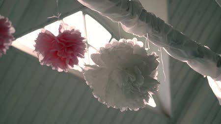 pom : Colorful paper decoration in shape of ball and flower on ceiling Stock Footage