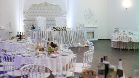 obrus : Tables set for an event party or wedding reception. luxury elegant table setting dinner in a restaurant. glasses and dishes indoors Wideo
