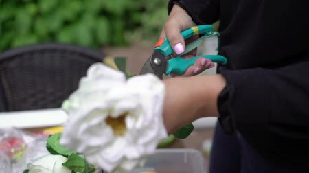 organizing : Arranging artificial flowers decoration. Young woman florist work making organizing diy artificial flower, craft and hand made concept. Decorating wedding ceremony.