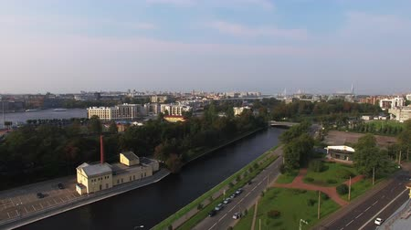 merkez : SAINT-PETERSBURG, RUSSIA - SEPTEMBER 22, 2018:Cityscape buildings and city river at sunny summer day aerial drone shot Stok Video