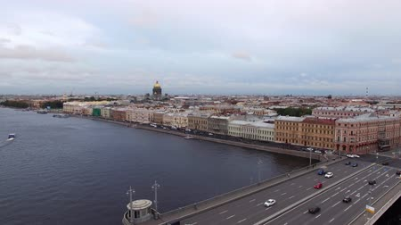 drawbridge : Wedding palace historical building in Saint-Petersburg at English embankment. Aerial drone cityscape view at street and river Neva at the evening in summer.