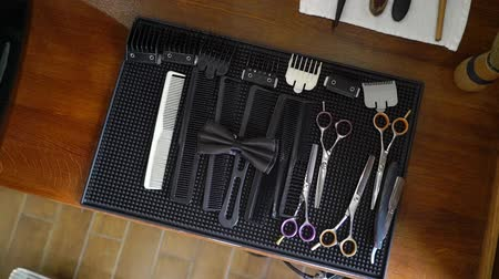 souprava : Professional barber shop tools and bowtie. Comb, scissors for hairstylist
