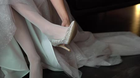 high heel shoe : Bride wearing bridal shoes. Morning wedding preparation