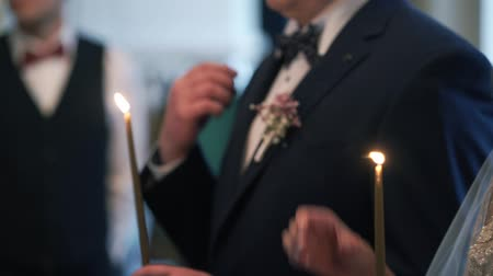 rahip : Bride and groom holding candles in church at christianity wedding ceremony Stok Video