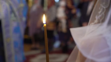 clergy : Bride and groom holding candles in church at christianity wedding ceremony Stock Footage