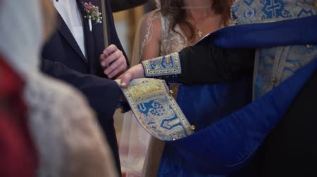 padre : Bride and groom holding hands in church at christianity wedding ceremony
