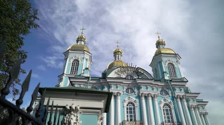 torre sineira : St. Nicholas Naval Cathedral in Saint Petersburg Russia baroque Orthodox cathedral. Sunny day Stock Footage