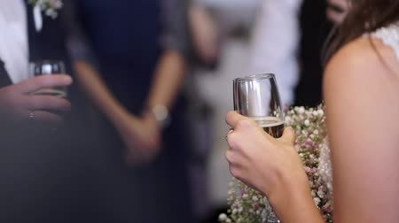 nowożeńcy : Bride and groom with glass of sparkling wine at the wedding party indoors