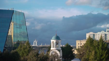 epiphany : White christianity church in a city. Religion Stock Footage